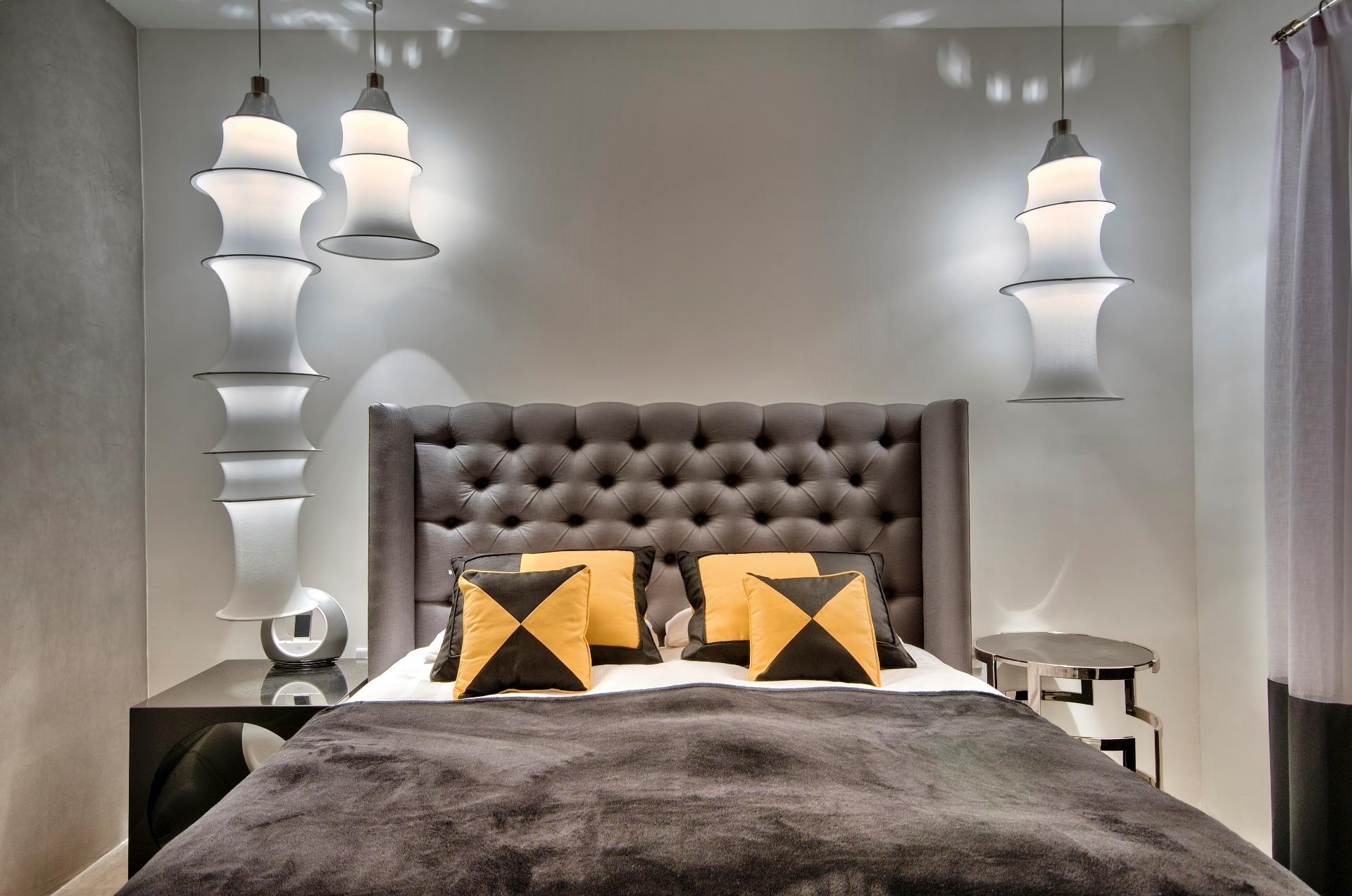 Main Bedroom- feature lights, throws, pillows, headboard