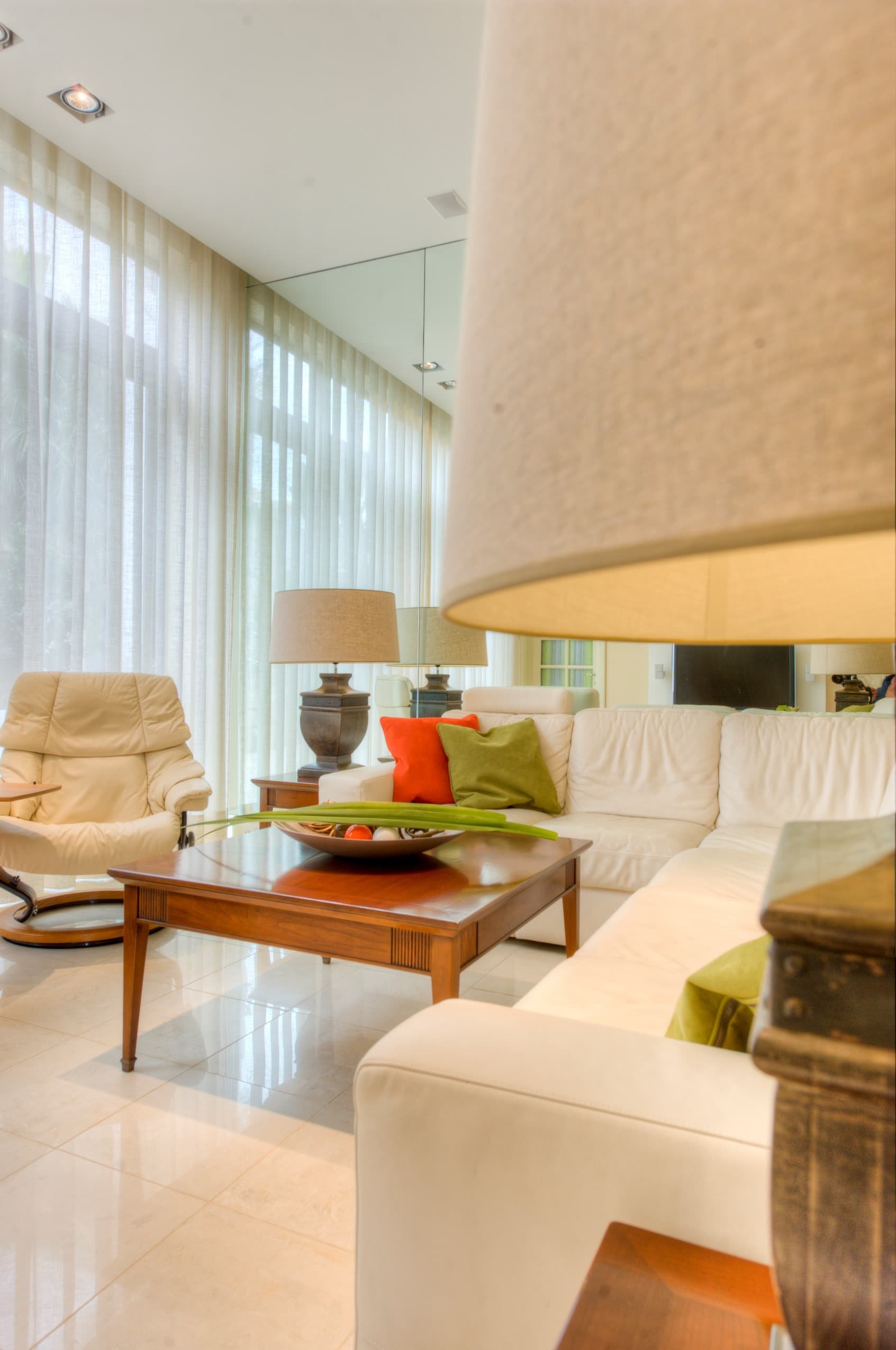 Contemporary Living Room – table lamps, accent colours, sofa, armchair