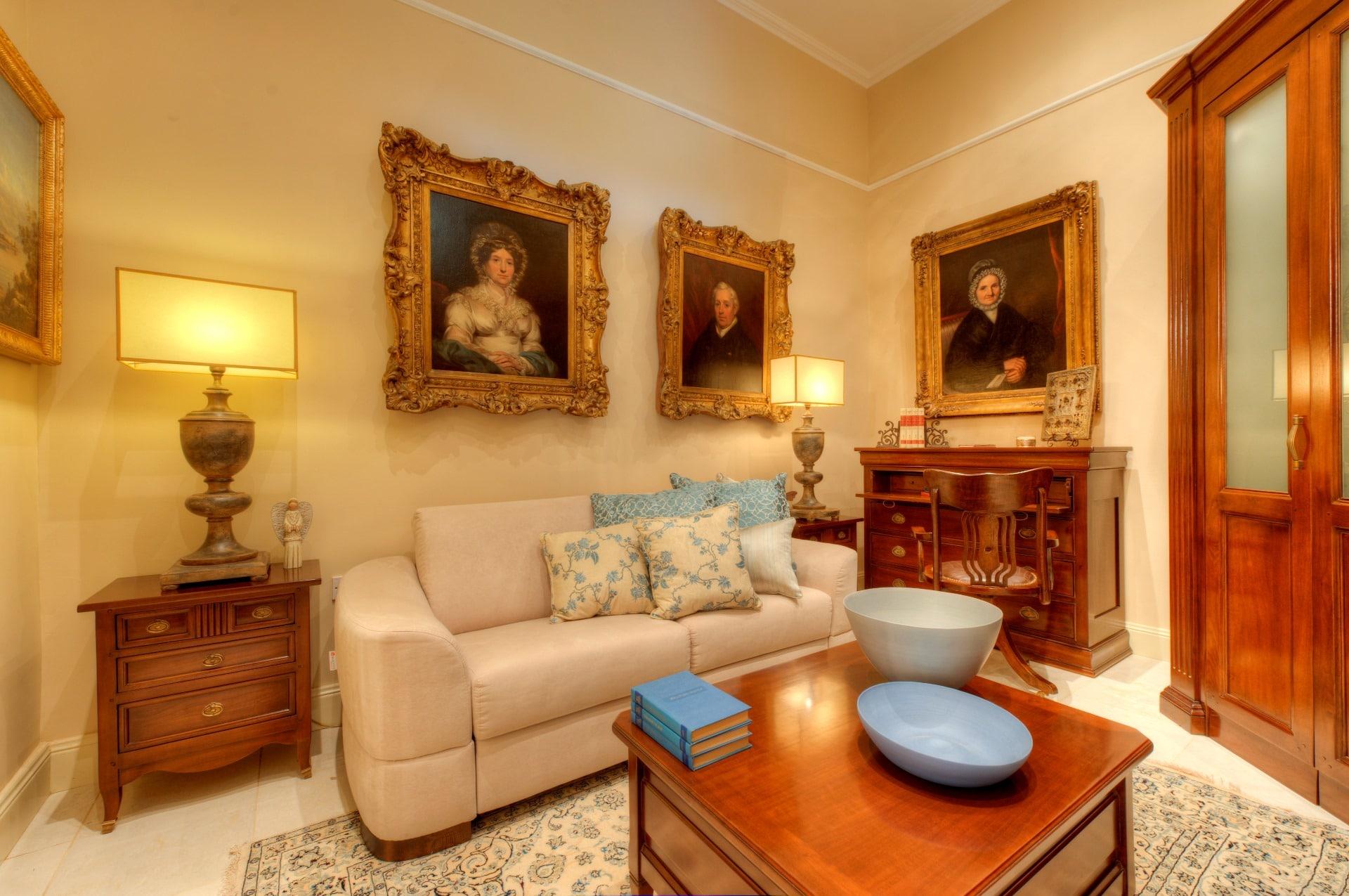 Linen Room – paintings, sofa, storage, carpet, lamps