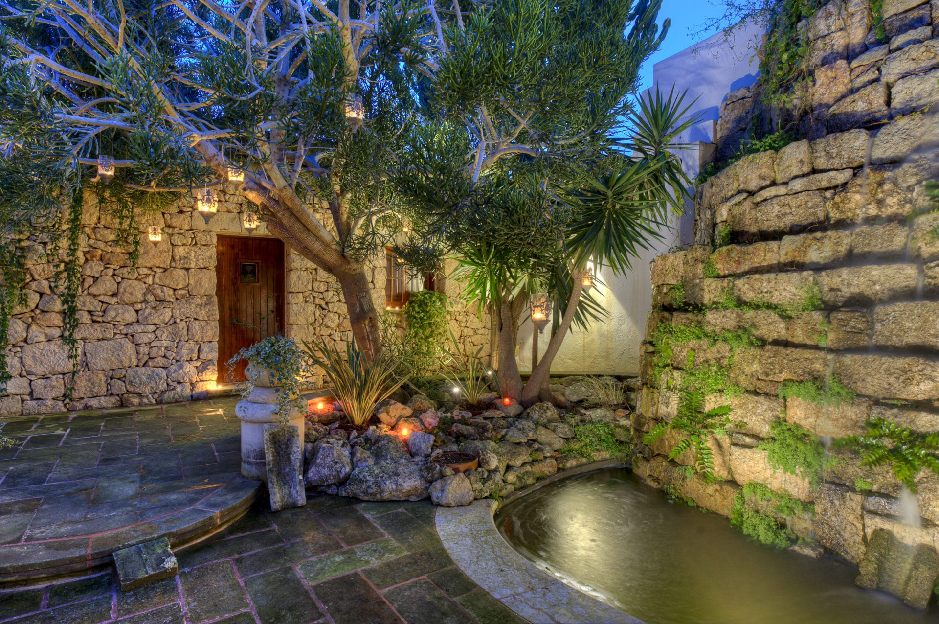 Garden – water feature, accent lighting, candles, landscaping, plants
