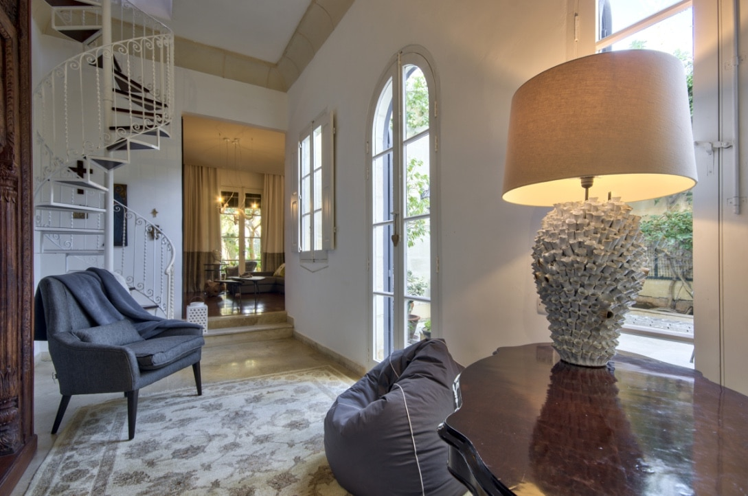 Corridor – spiral staircase, feature task lighting, carpets, arched doors, decorative metal