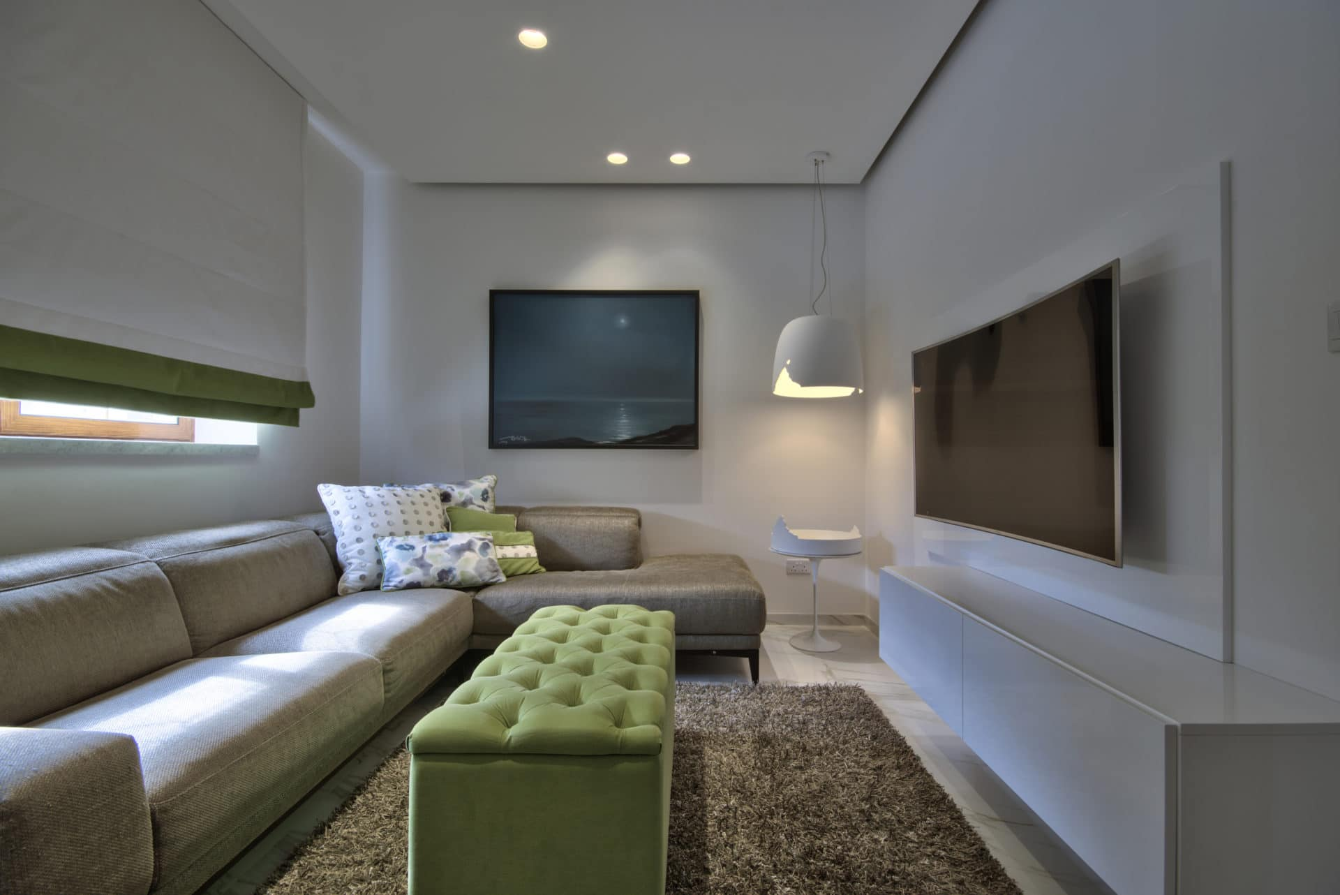 Living Room – light feature, artwork, sofa, ottoman, colour scheme