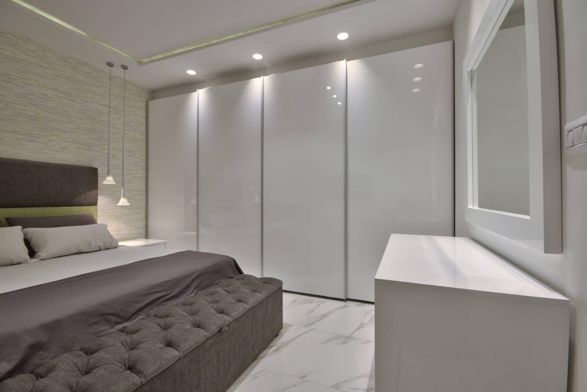 Main Bedroom – wardrobe, bedding, ottoman, wallpaper, pendant lights