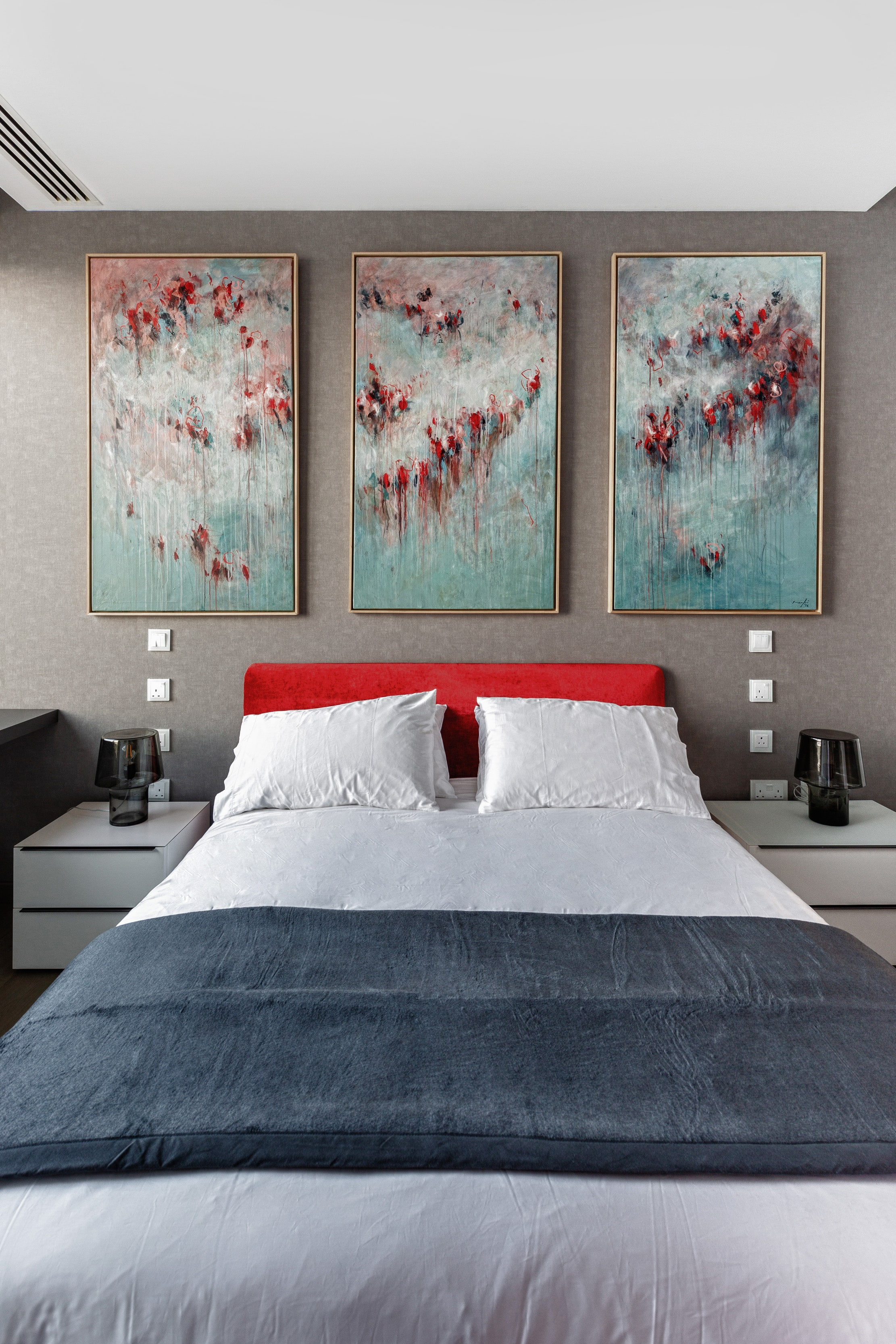 Paintings in bedroom bringing in colors from the seafront
