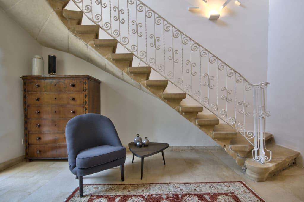 Chest, stairway and armchair